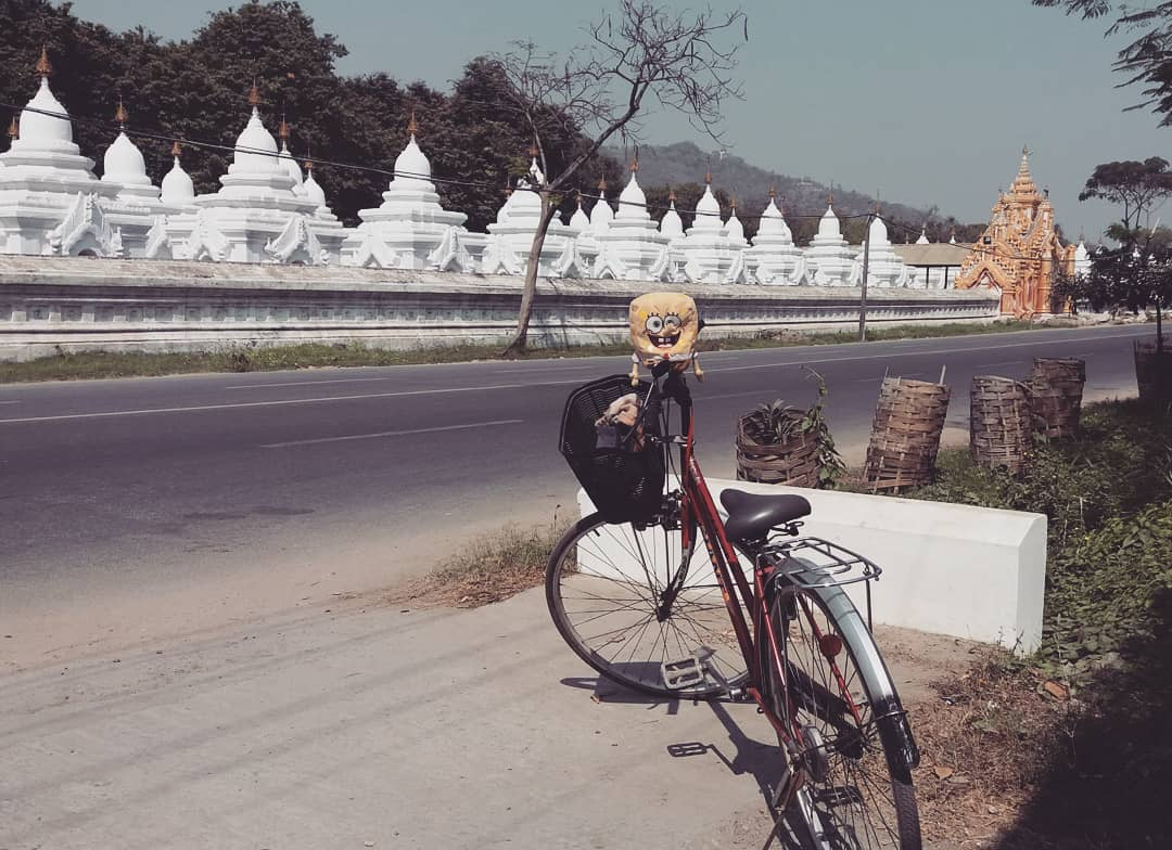 Riding bicycle in Mandalay, Myanmar